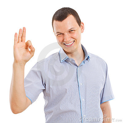 Happy young business man showing ok sign