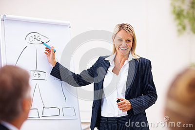 Happy young business woman at a boardroom meeting