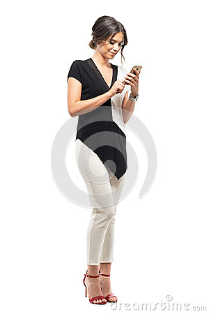 Free Happy Young Business Woman In Formal Suit Relaxing And Typing On The Mobile Phone. Royalty Free Stock Image - 99227696