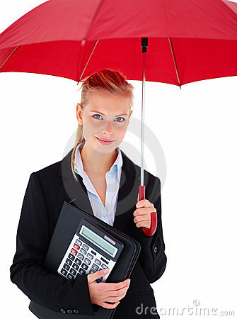 Happy young business woman standing under umbrella