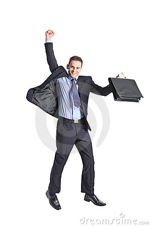 A happy young businessman jumping