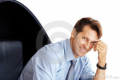 Happy young businessman sitting on chair