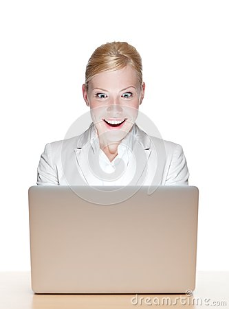 Happy young businesswoman sitting with laptop