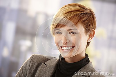 Happy young businesswoman in spring sunshine Stock Photo