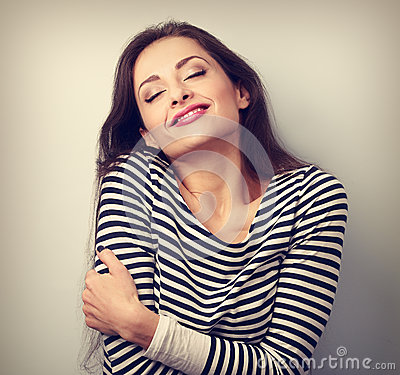 Free Happy Young Casual Woman Hugging Herself With Natural Emotional Stock Photo - 62749140