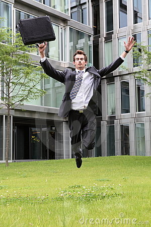 Happy young caucasian businessman jumping