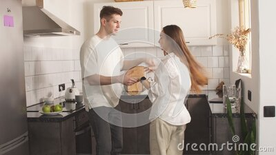 Happy young couple dancing at home stock video