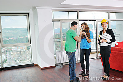 Happy young couple buying home