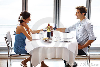 Happy young couple on date in restaurant