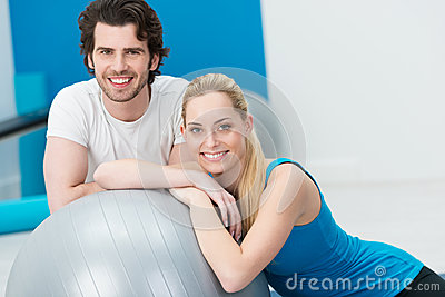 Happy young couple doing fitness training