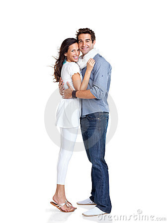 Happy young couple embracing each other on white