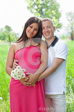 Happy young couple expecting a baby