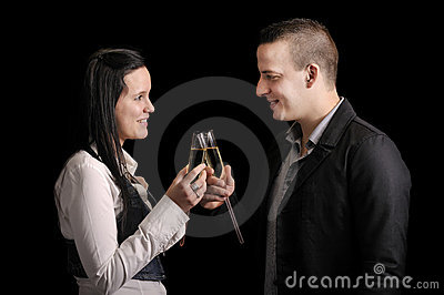 Happy young couple having a drink