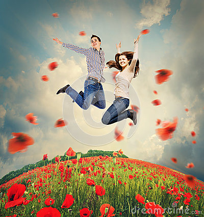 Free Happy Young Couple Jumping In Poppies Field Stock Image - 40273641