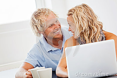 Happy young couple with laptop