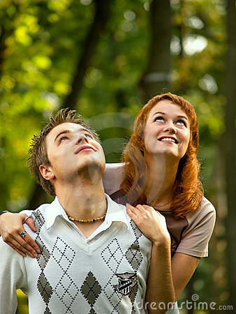 Happy young couple looking upwards