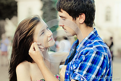 Happy young couple in love in city