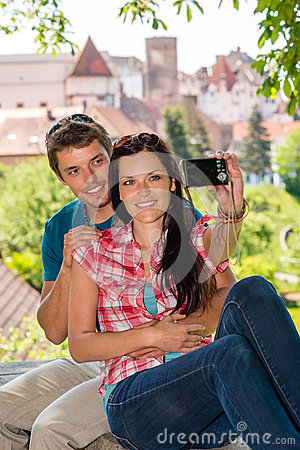 Happy young couple photographing themselves