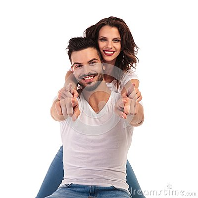 Free Happy Young Couple Pointing Fingers Together Stock Photo - 110266610