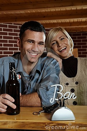 Happy young couple in pub