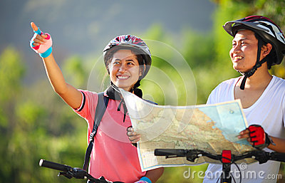 Happy young couple riding a bike