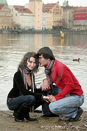 Happy young couple by river