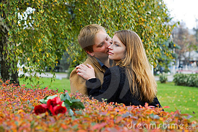 Happy young couple with a roses.