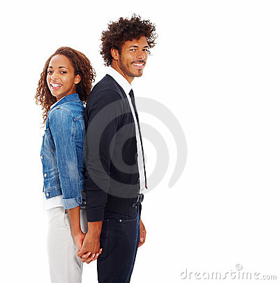 Happy young couple standing back to back