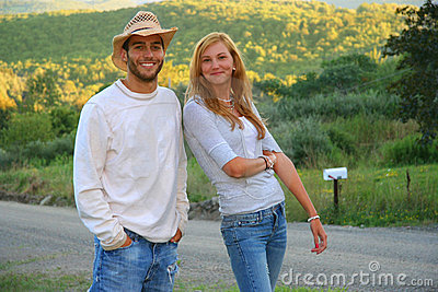Happy Young couple standing in rural area.