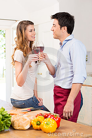 Happy Young Couple Toasting Wine Glass