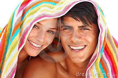Happy young couple with a towel on their heads