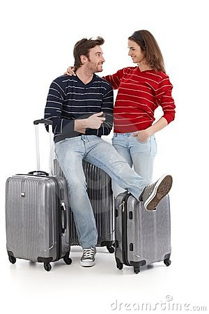 Happy young couple travel with baggages