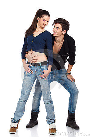 Happy young couple wearing jeans