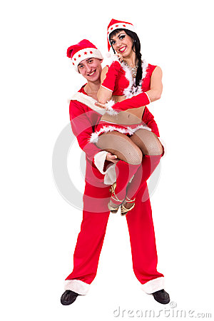 Happy young couple wearing santa claus clothes