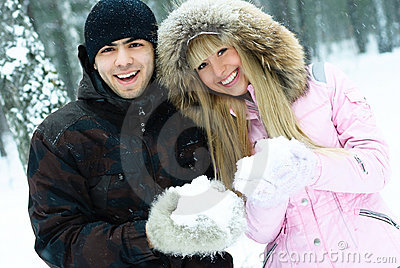 Happy young couple in winter park