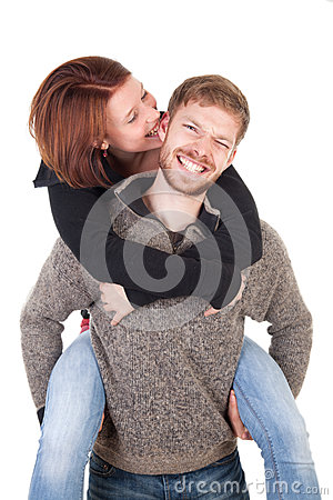 Happy young couple - woman lovingly biting man