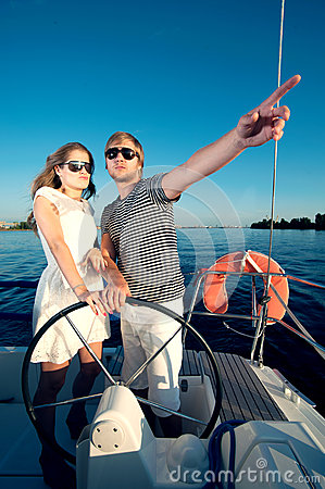 Happy young couple on a yacht
