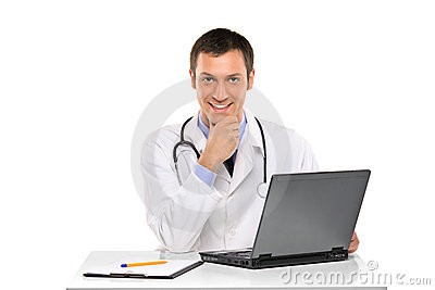A happy young doctor working on a laptop