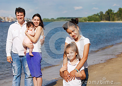 Happy young family with children outdoor