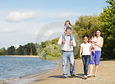 Happy young family with children outdoor near the river