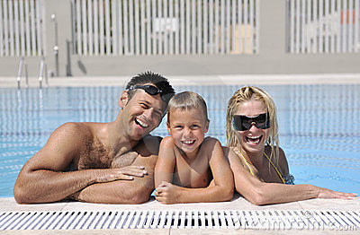 Happy young family have fun on swimming pool
