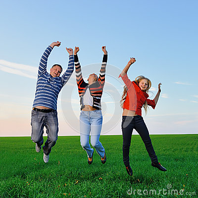 Happy young family jump for joy