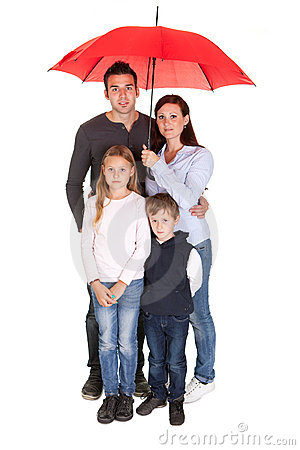 Free Happy Young Family Standing Under One Umbrella Royalty Free Stock Photography - 22297627