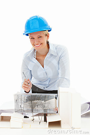 Happy young female architect with a model building