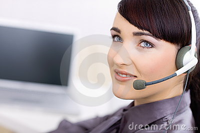 Happy young female customer service operator