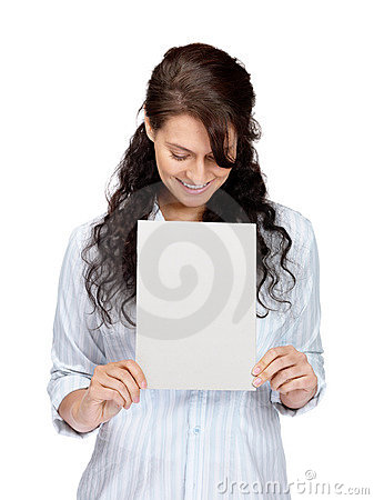 Happy young female looking at blank billboard