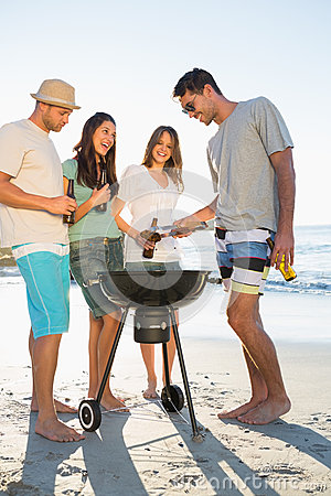 Happy young friends having barbecue together