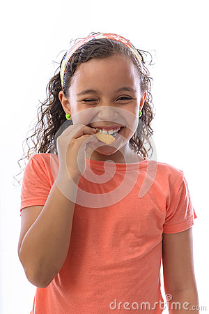 Happy Young Girl Eating Biscuit