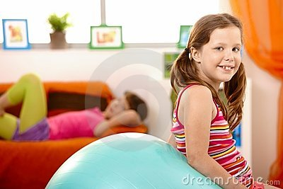 Happy young girl with gym ball