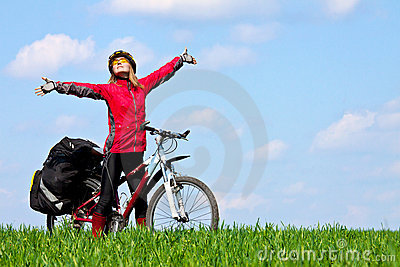 Happy young girl on mountain bike